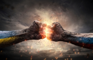 Conflict, close up of two fists hitting each other over dramatic