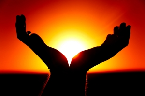Hands and the Rising Sun